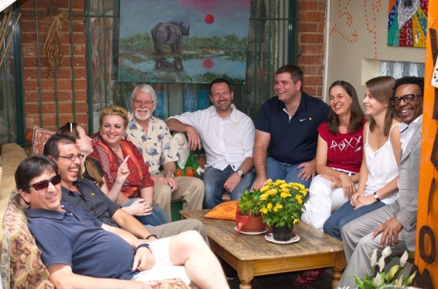 A group hug at the Author's Lunch in November with (from left) David Bullard, Bruce Sutherland, Michael Seers, Peter Piegl, Sean Newman, Athele Oosterbroek, Fiona Snyckers and Eric Miyeni