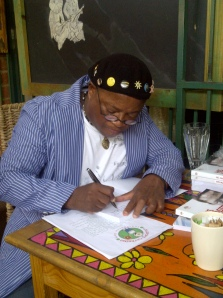 Sandile Memela doing a book signing after chatting to us at Indulgence