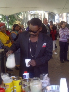 Dali Tambo helping himself to tea on the set of People of the South, the Flash mob scene